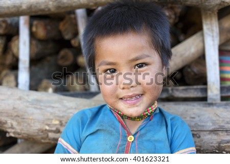 KENGTUNG, MYANMAR - JANUARY 21, 2016: A portrait of a child from the Lahu Shi tribe. They are a self sufficient Buddhist tribe who live on the top slope of a mountain and farm their land.