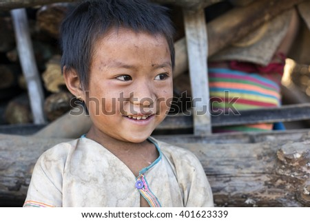 KENGTUNG, MYANMAR - JANUARY 21, 2016: A portrait of a child from the Lahu Shi tribe. They are a self sufficient Buddhist tribe who live on the top slope of a mountain and farm their land. - stock photo