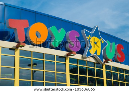 KENNESAW, GA - MARCH 21, 2014: Sign at Toys R Us location in Kennesaw, GA, on March 21, 2014. The retailer announced cuts of 200 jobs at corporate headquarters and plans to close stores nationally. - stock photo