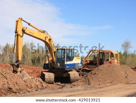 KENNETCOOK, CANADA - MAY 29, 2016: Komatsu excavator and Dresser bulldozer at rural construction site. - stock photo