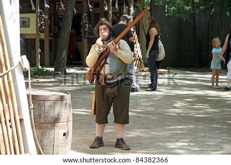 KENOSHA, WI - AUGUST 21: An actor as medieval soldier prepares to shot at the annual Bristol Renaissance Faire on August 21, 2011 in Kenosha, WI