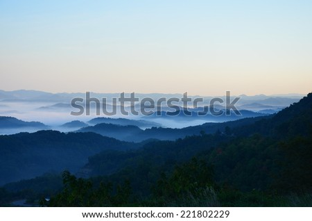 Kentucky Appalachian Mountains at sunrise with fog in the valleys - stock photo