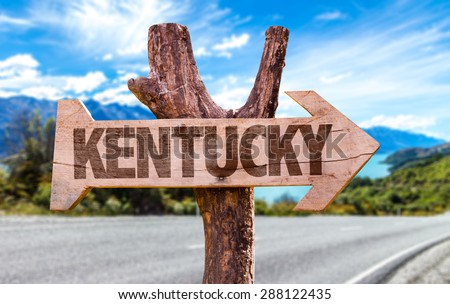 Kentucky wooden sign with road background - stock photo