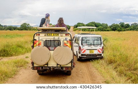 Kenya. Africa- March 7, 2016: People taking pictures of wild animals on a Safari tours  in Kenya, Africa