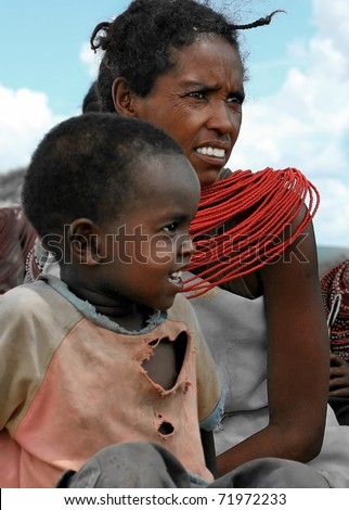 KENYA, AFRICA - NOVEMBER 8: A woman with her child, typical daily life of local people, near Samburu National Park Reserve, on November 8, 2008 in Kenya, Africa - stock photo