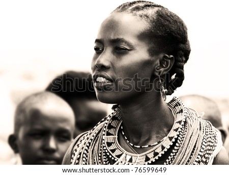 KENYA, AFRICA - NOVEMBER 8: Portrait of Samburu woman wearing traditional handmade accessories, review of daily life of local people, near Samburu Park National Reserve on November 8, 2008 in Kenya, Africa - stock photo