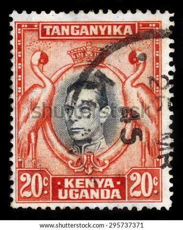 KENYA, UGANDA AND TANGANYIKA - CIRCA 1946: A stamp printed in British Territory of Tanganyika shows medallion portrait of King George V, surrounded of storks, circa 1946 - stock photo