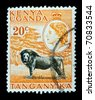 KENYA, UGANDA AND TANGANYIKA - CIRCA 1958: A stamp printed in East Africa showing image of a lion in the savannah, circa 1958. - stock photo