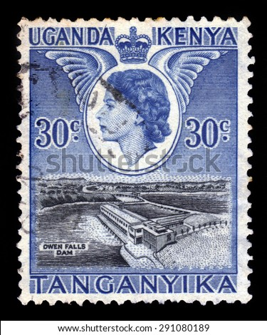 Kenya Uganda Tanganyika - CIRCA 1954: a stamp printed in United Kingdom shows Queen Elizabeth II and  Owen Falls Dam, circa 1954 - stock photo