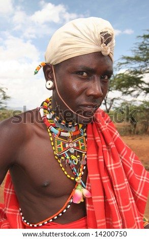 KENYA - UNKNOWN: A  Masai man poses for a portrait in this undated image taken in Kenya