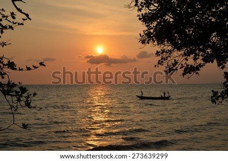 Kep,Cambodia. Fishing boat returns at sunset - stock photo