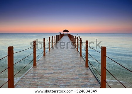 Kerachut Beach jetty at sunset. Nature composition