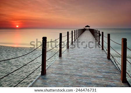 Kerachut Beach Jetty with seascape sunset view. Nature composition. - stock photo