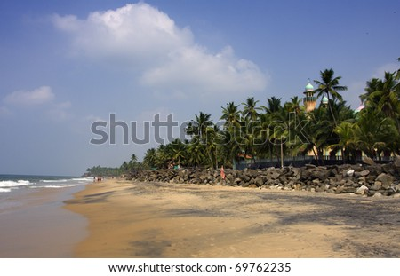 Kerala beach, India with mosque and palms - stock photo