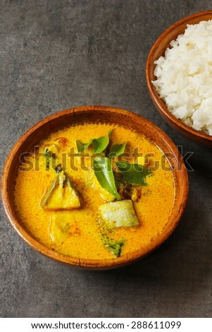Kerala fish curry served in a wooden bowl