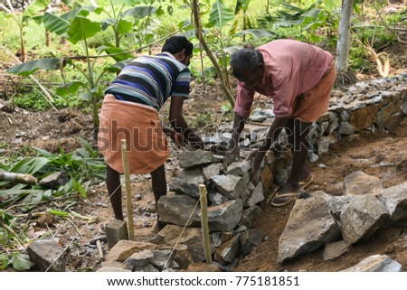 Kerala  INDIA   FEBRUARY 10  Workers at construction site Kerala  India   Building. A Compound Wall Stock Images  Royalty Free Images   Vectors
