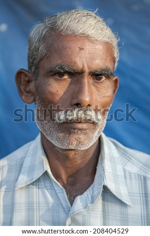 KERALA, INDIA - NOVEMBER 26: An unidentified indian man poses for a portrait on November 26, 2011 in Kerala, India