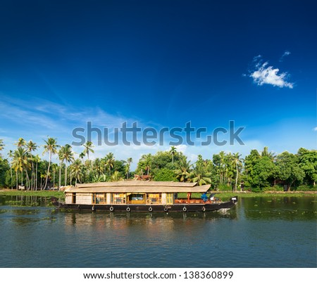 Kerala India travel background - Houseboat on Kerala backwaters. Kerala, India