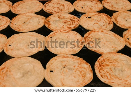 Kerala paratha / porotta / roti / parotta / barotta is a layered flatbread made from maida flour South Indian Kerala food, India. Tamil Nadu Sri Lankan. cooking using wheat flour dough