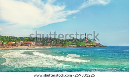 Kerala province beach in India with a vivid lighthouse in the ocean. Creative filter affect - stock photo