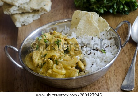 Keralan chicken curry with rice and poppadom - stock photo