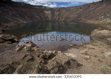 KERID, ICELAND - JUNE 02, 2015: Privately owned volcanic crater lake on the popular tourists route known as Golden Circle - stock photo