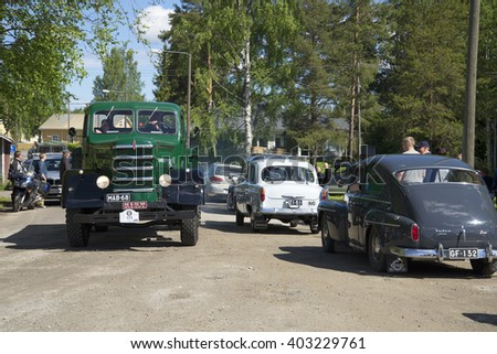 KERIMYAKI, FINLAND - JUNE 06, 2015: Participants of the parade of vintage cars on the streets of the town Kerimyaki