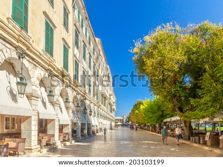 KERKYRA, CORFU, GREECE - SEPTEMPER 24 2013: Famous cafes at building at Kapodistriou street with lot of tourists. This street located near platia Enoseos at old city. - stock photo