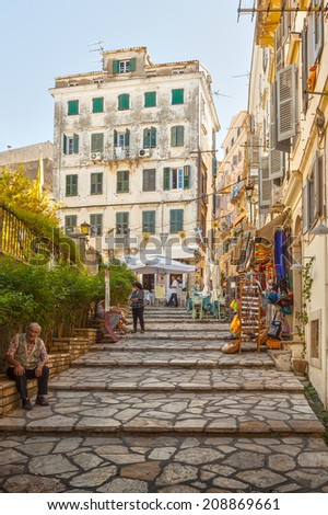 KERKYRA, CORFU, GREECE - SEPTEMPER 24 2013: Tourists walking and shopping on narrow streets of historical city center of Kerkyra, Corfu, Greece - stock photo