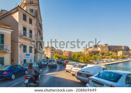 KERKYRA, CORFU, GREECE - SEPTEMPER 24 2013: View to the New Fortress of Corfu from embankment of Ionian sea with lot of cars parked. Architect of the fort was the military engineer Ferrante Vitelli - stock photo