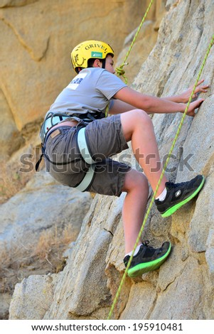 KERN COUNTY, CA-MAY 31, 2014: Teen students from Olive Knolls Christian School are getting climbing instruction today. First to go is Stevie Hall, making it look (almost) easy.