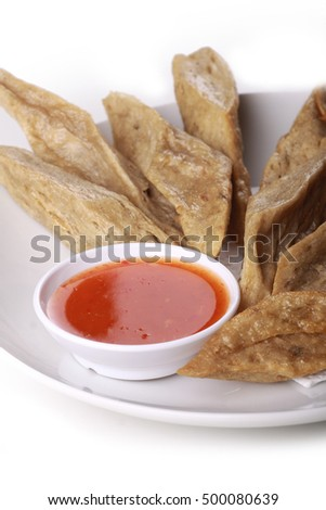keropok lekor served with chili sauce isolated on white background