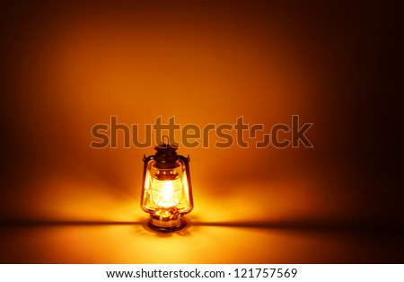 Kerosene lamp illuminated, concept gold lighting
