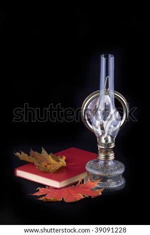 kerosene lamp with a book and maple leaves