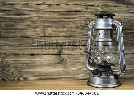kerosine lamp with  wooden background