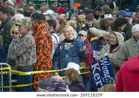 Kerry supporter dons a George W. Bush mask during a Kerry/Edwards mid-October bus tour through rural southern Ohio - stock photo
