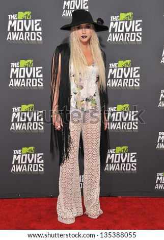 Kesha at the 2013 MTV Movie Awards at Sony Studios, Culver City. April 14, 2013  Los Angeles, CA Picture: Paul Smith - stock photo