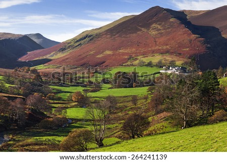 Keskadale and surrounding fells. A lovely view of Keskadale and the mighty fells which surround it. - stock photo