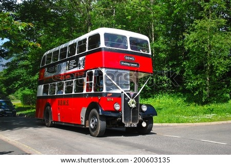 KESWICK, ENGLAND - JUNE 5. A veteran double deck bus in use as wedding transport  on June 5, 2014, Keswick, England. - stock photo