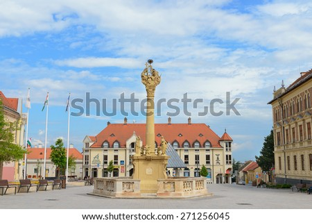KESZTHELY, HUNGARY - APRIL 21, 2014: Fo ter (square) and Holy Trinity column in Keszthely town. Keszthely is important cultural, educational and economic hub in Hungary - stock photo