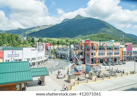 "KETCHIKAN,AK,USA-JUNE 30: Tourism is the major income source for historic Ketchikan Alaska on June 30, 2015. Ketchikan, the ""Salmon Capital of the World"", can dock up to three cruise ships per day."
