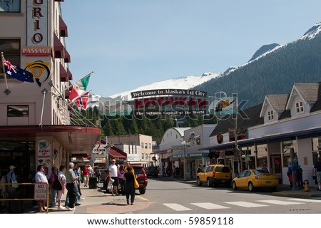 KETCHIKAN, ALASKA - JUNE 4:  View of welcome sign over Mission Street where tourists shop for souvenirs on June 4, 2009 in Ketchikan, Alaska.