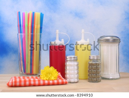 Ketchup, Mustard and Sugar on Blue Textured Background
