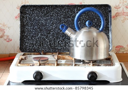 kettle and gas cooker on modern kitchen - stock photo