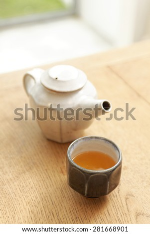 kettle and tea cup on table