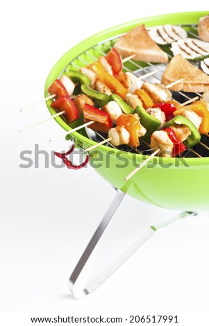 kettle barbecue grill with skewers - stock photo