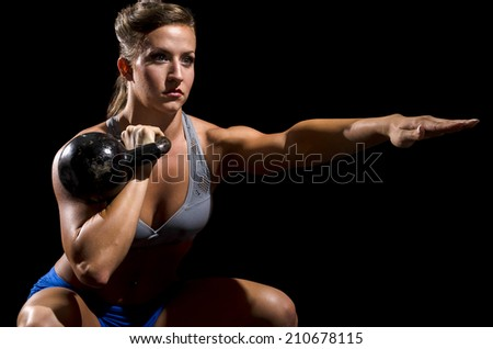 Kettle bell squat  - stock photo