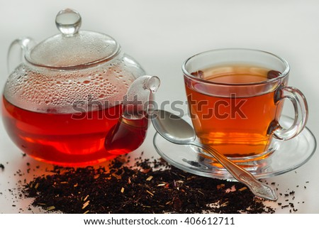 Kettle, Cup and tea. - stock photo