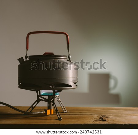 kettle for tea camp on a gas burner - stock photo