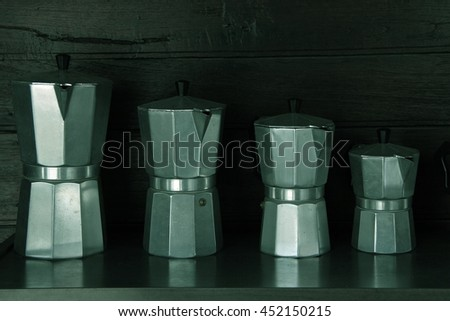 Kettle Hot water ancient made of stainless steel - stock photo